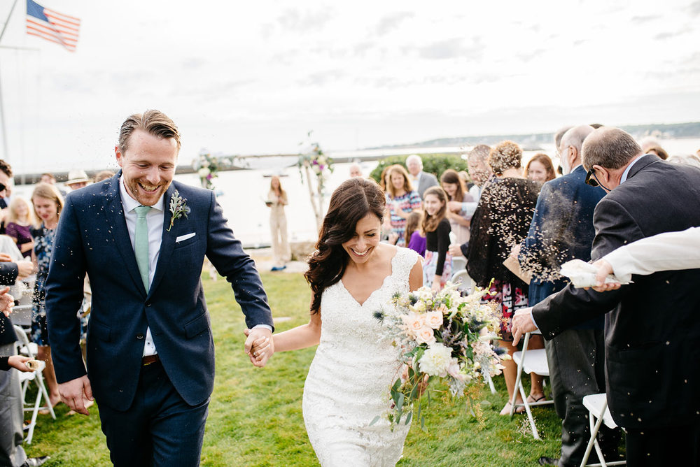 lavender at weddings inspiration of bride and groom tossing lavender eastern point yacht club in Gloucestor, MA