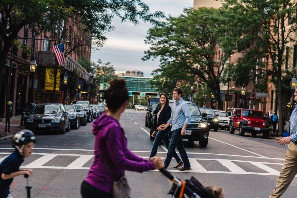lifestyle boston couple walking across charles street boston engagements