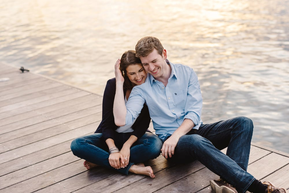 lovely couple cuddling on the boston esplanade during their fun engagement session