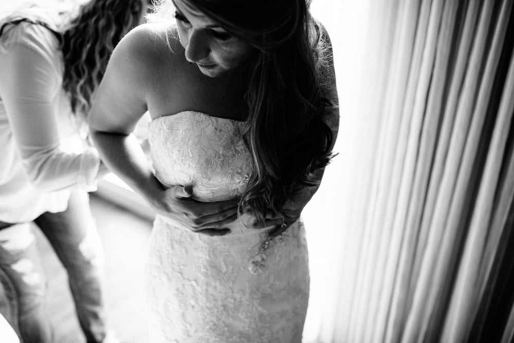 creative bride getting ready in her hotel room in newton ma, boston wedding photographers