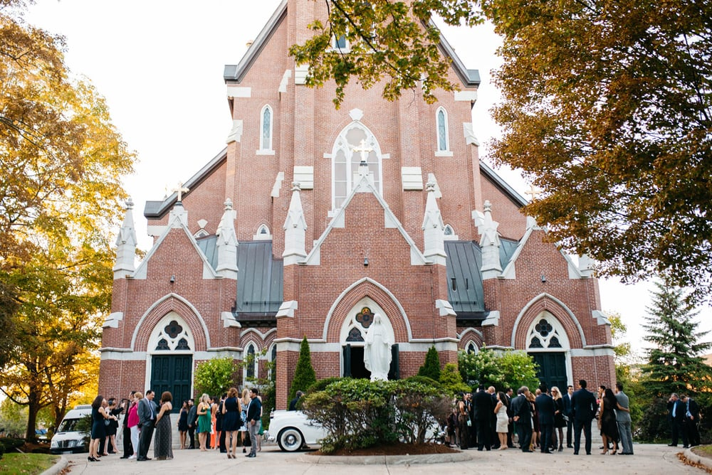 beautiful wedding at the Our Lady's Help of Christian's Parish outdoor patio wedding photography