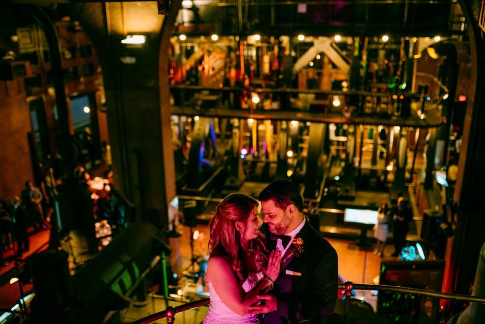 Metropolitan Waterworks Museum  couple being cute inside creative wedding venues in boston