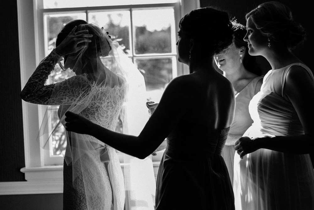 bride and bridesmaids wedding in groom getting ready in a michigan wedding eve at the b.o.b. in michigan