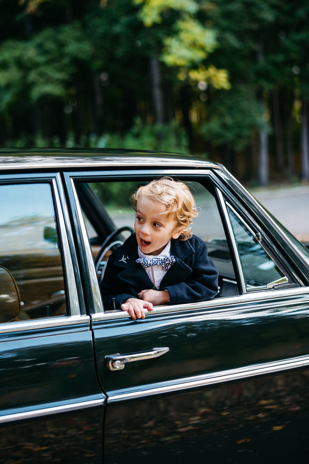 cute kid in car vintage mercedes lifestyle at aquinas college