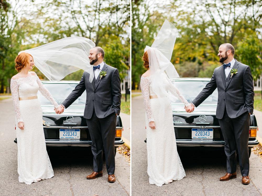 wind blow brides veil at a lovey boho backyard michigan aquinas college wedding
