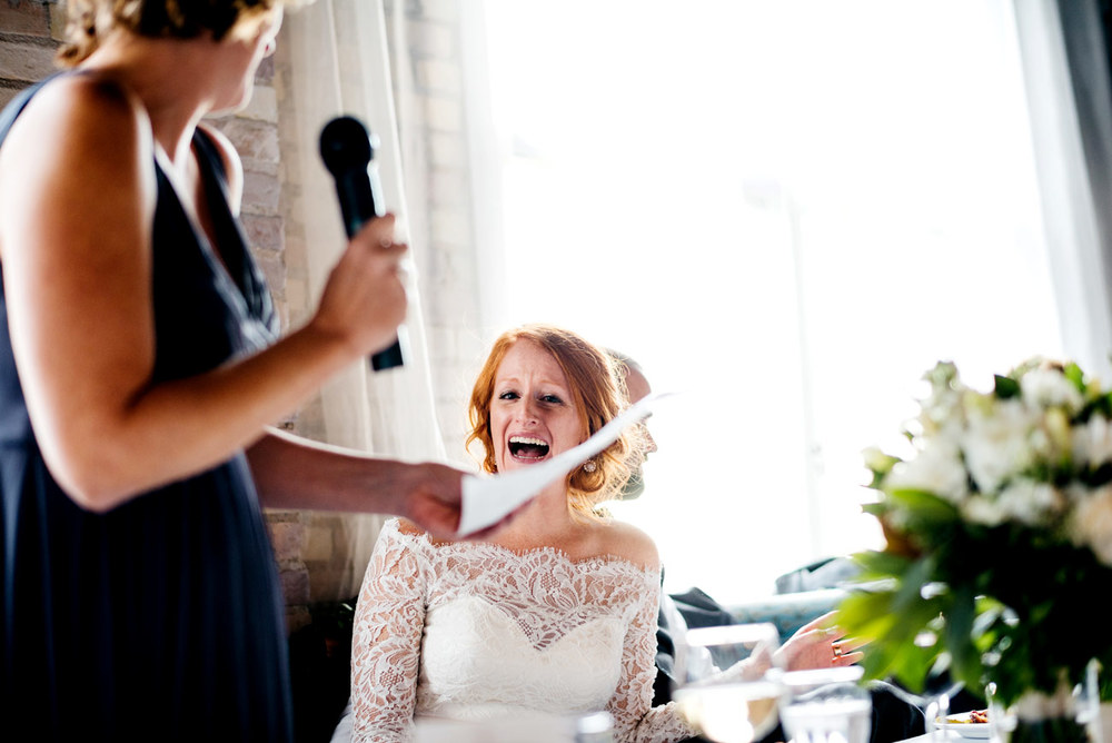 bride and maid of honor wedding inspiration photos funny reaction at eve at the b.o.b. in michigan