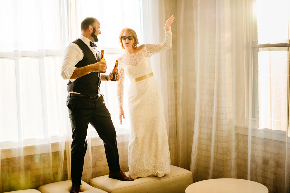 bride and groom having fun with sunglasses on in eve at the b.o.b. in michigan wedding photography