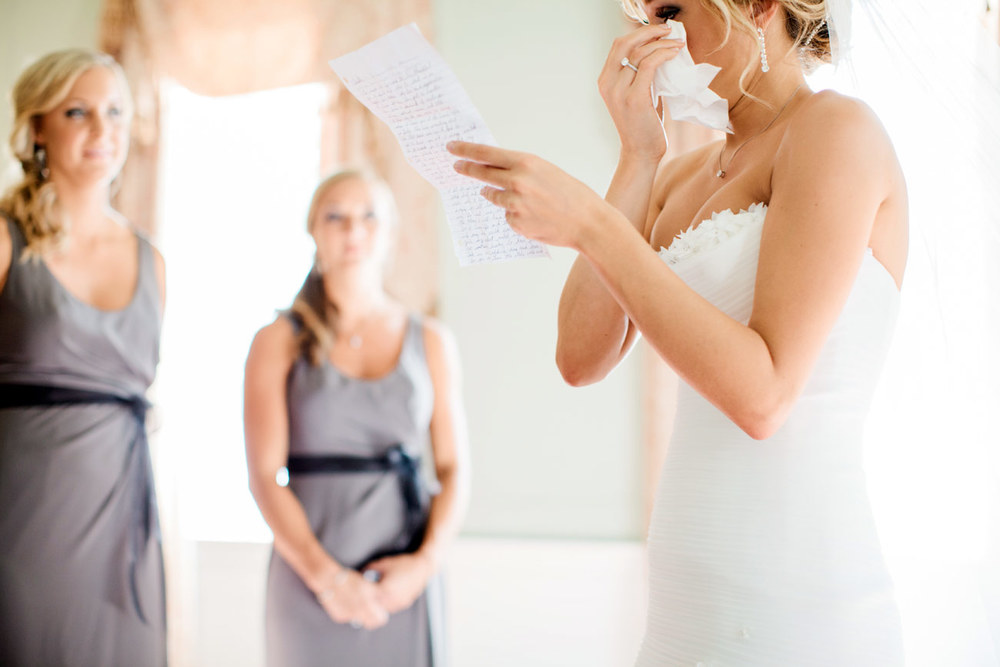 bride getting ready for a wedding at the lowndes grove plantation in charleston, sc destination charleston weddings