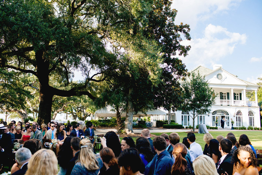bride walking down the isle from lowndes grove plantation in charleston sc destination weddings