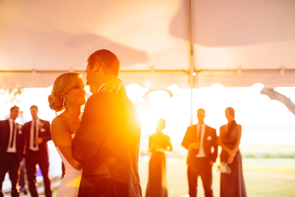golden light first dance at the lowndes grove destination wedding in charleston sc tent wedding inspiration