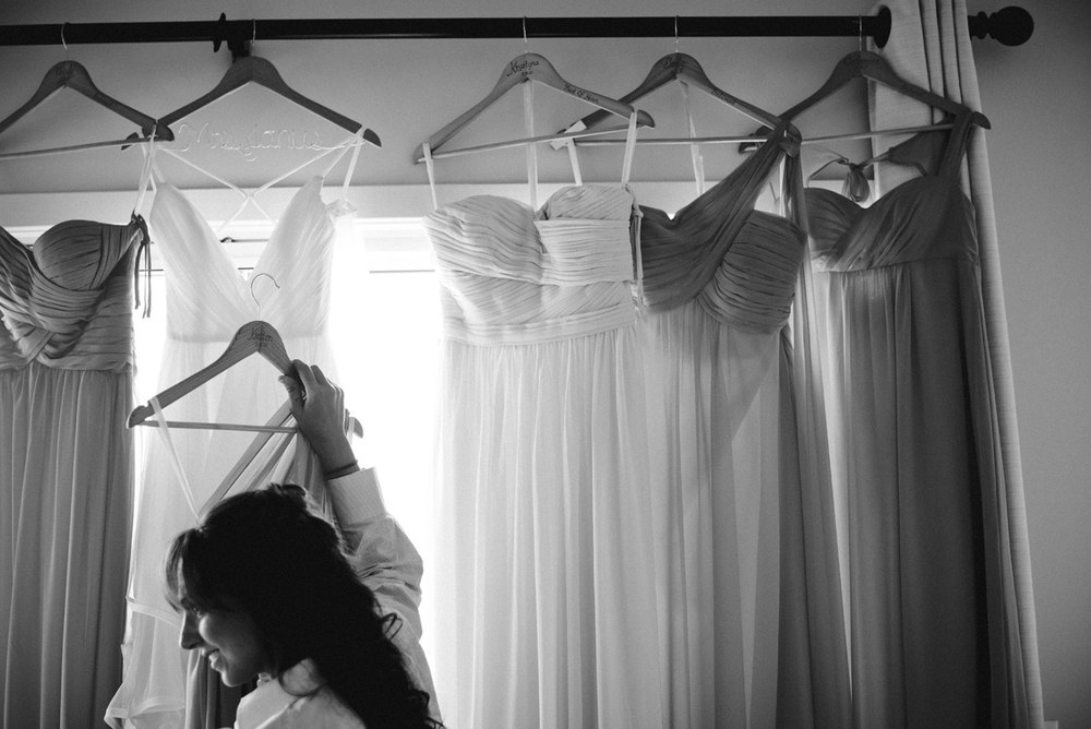 creative bridal getting ready photo bridesmaid holding dress