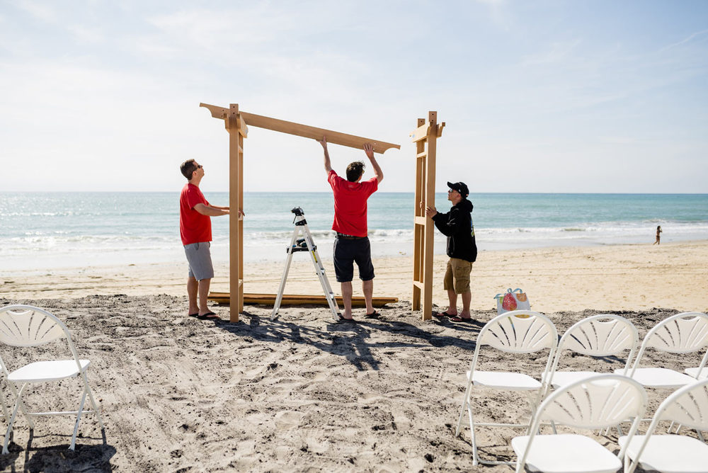 setting up the custom arbor on carlsbad beach at levyland