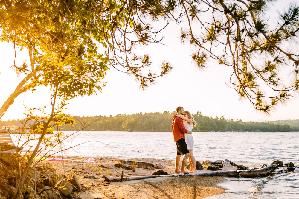 beautiful sunset engagement photography on Lake winnipesaukee