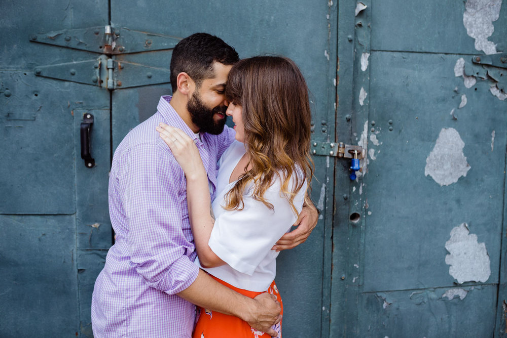 lifestyle couple photos in boston rustic metal door in fort point
