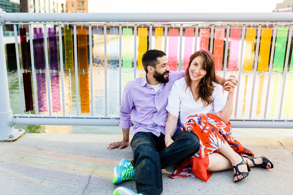 cute couple sitting on colorful bridge in boston, congress street area fort point photos