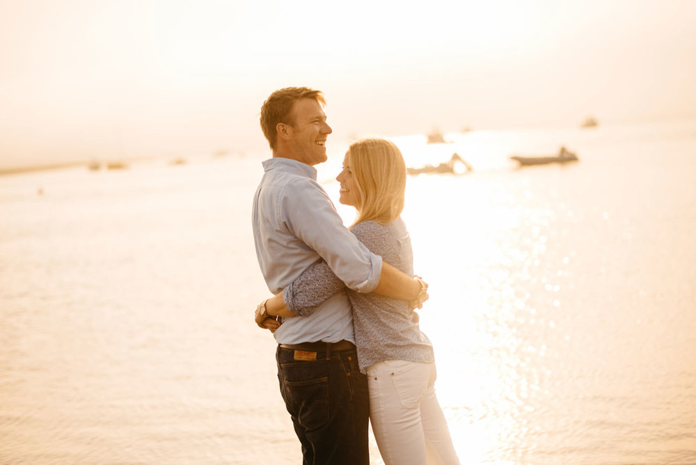sunny evening in essex ma, a lovey couple on the beach during their engagement session