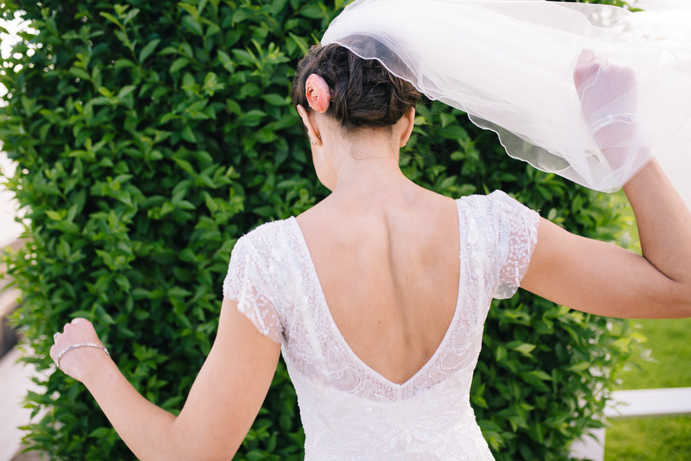 beautiful bride in cape cod showing her stunning dress back of dress weddings