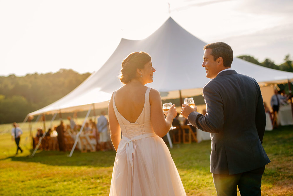 bride and groom walking to the beautiful sperry tent at bourne farm cape cod tent weddings