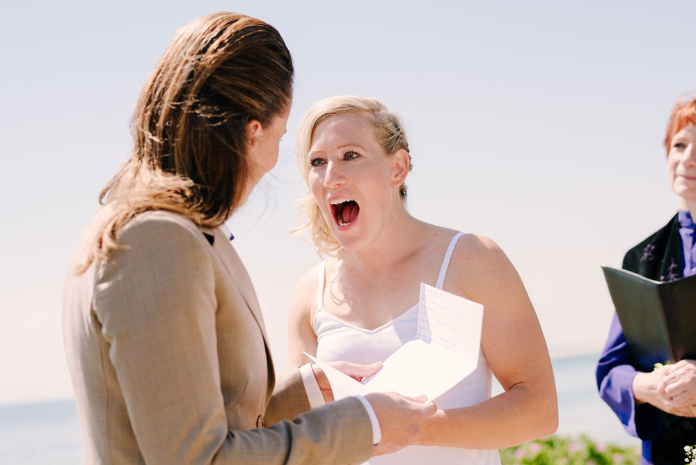 bride excited with her partner same sex provincetown beach elopement