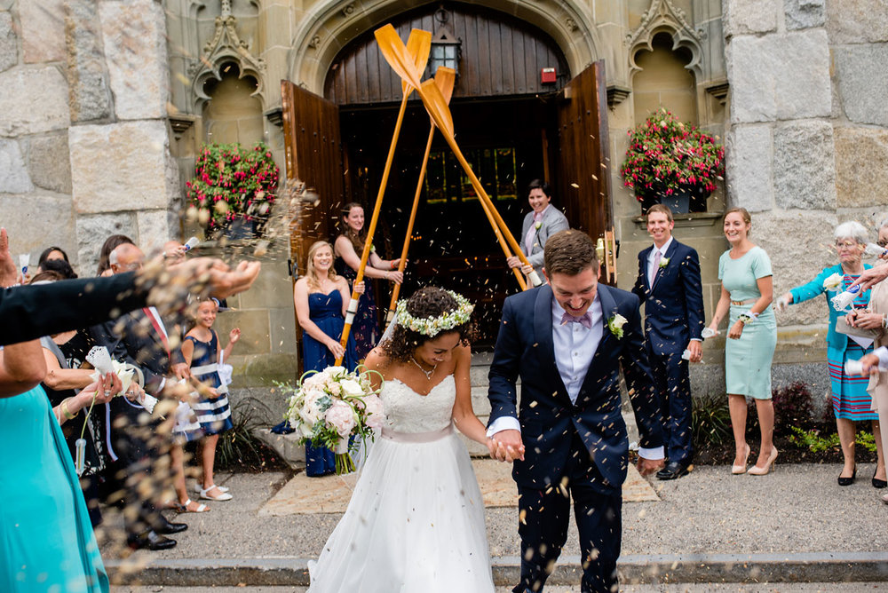 amazing bride and groom exit through wooden oars