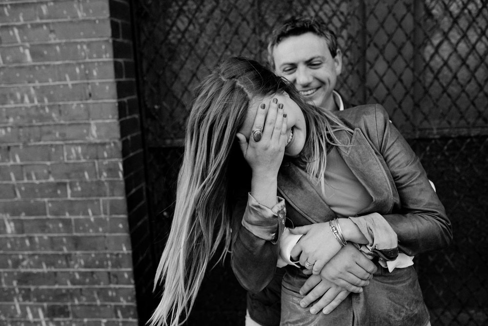 fun and crazy boston engagement photos, couple laughing