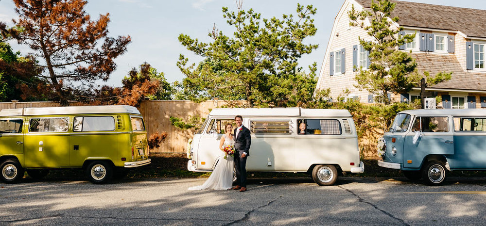 bride and groom with three vw busses at their wedding