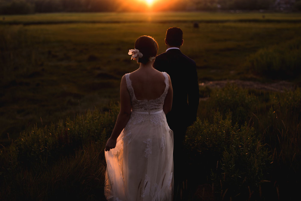 romantic moody portrait of bride and groom in new england