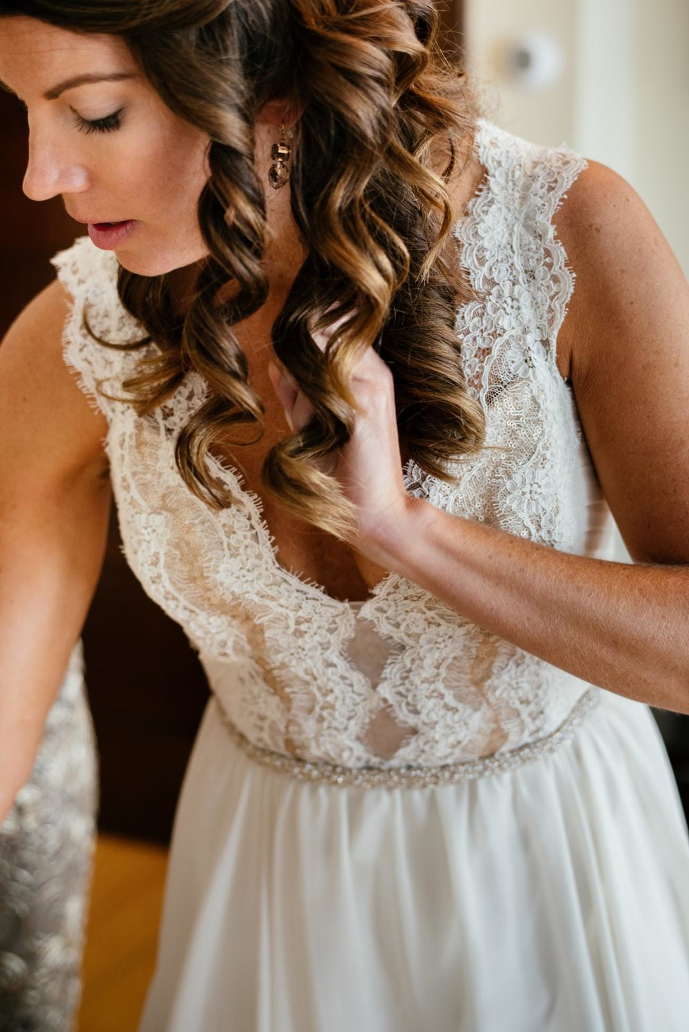 destination weddings stunning bride getting ready in maine barn and coastal wedding