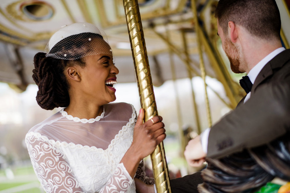 lifestyle wedding portraits on the carousel in the boston commons
