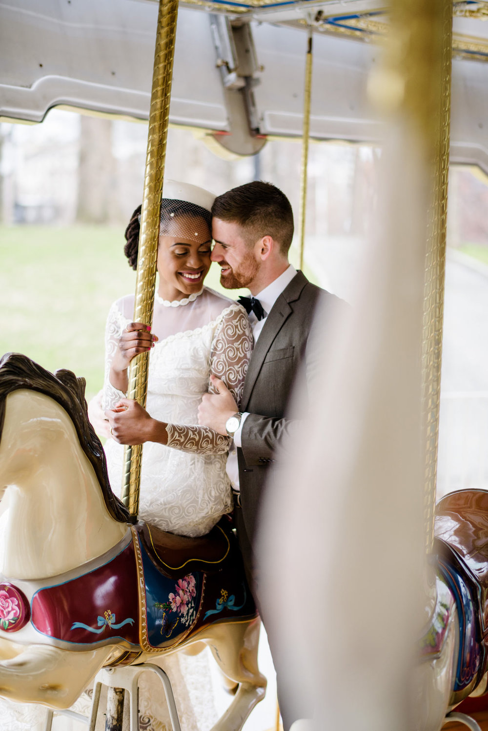 lovely couple wedding portraits in the spring on the carousel