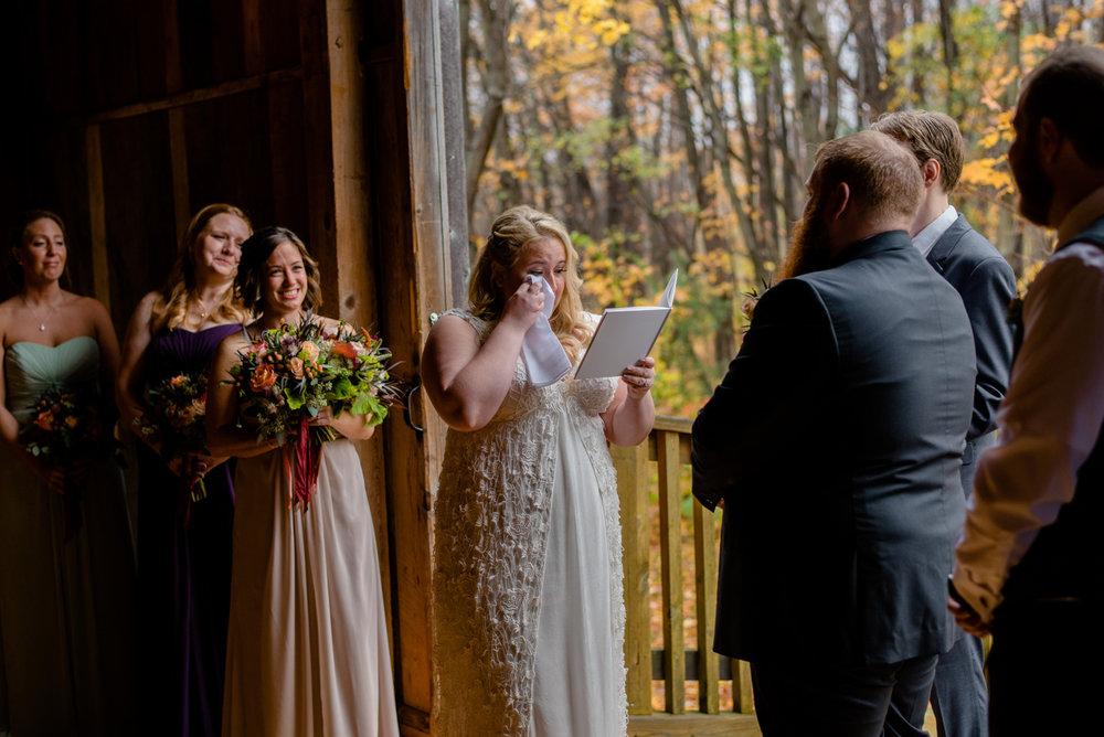 bride having a moment inside the barn on walnut hill