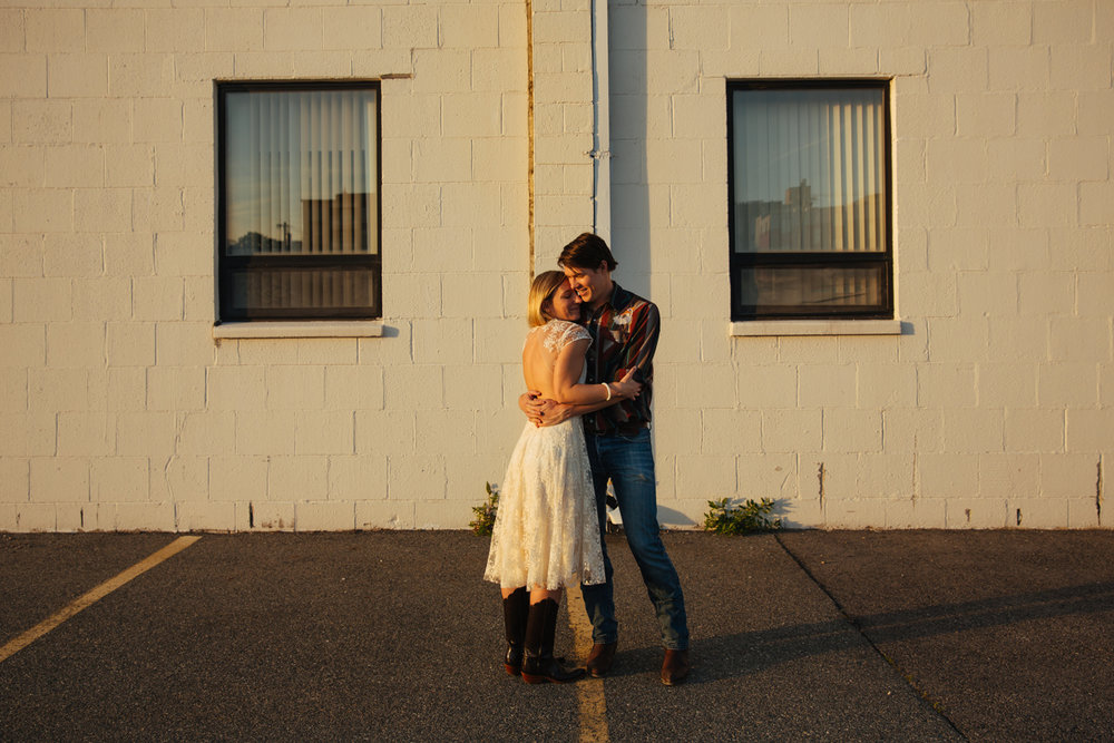 sunset urban modern photographers bride in creative wedding dress