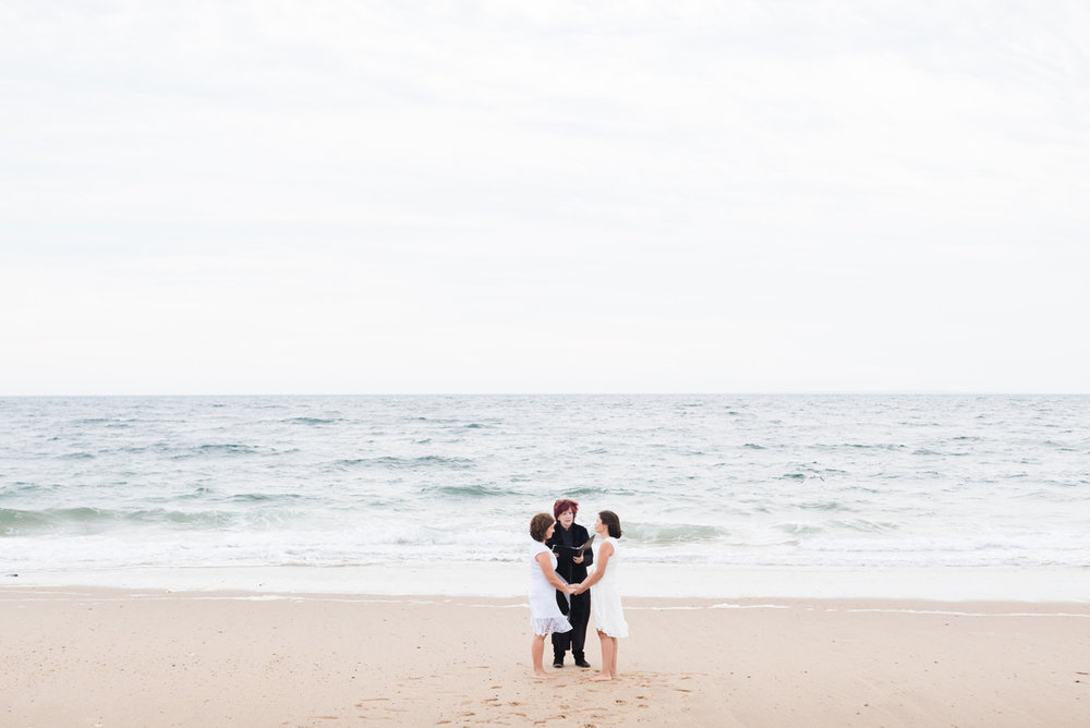 same sex couple getting married on the beach in provincetown
