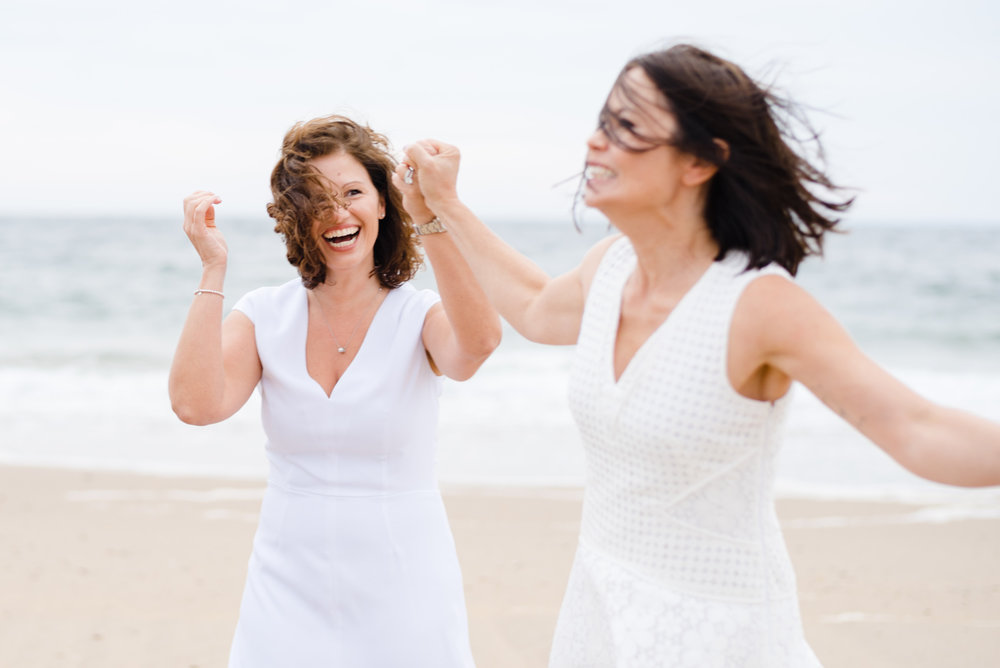 fun lifestyle candid moment after same-sex couple got married
