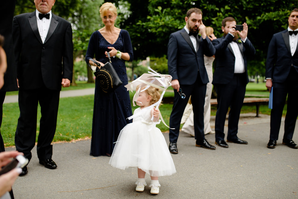 candid lifestyle moments of flower girl with a head piece