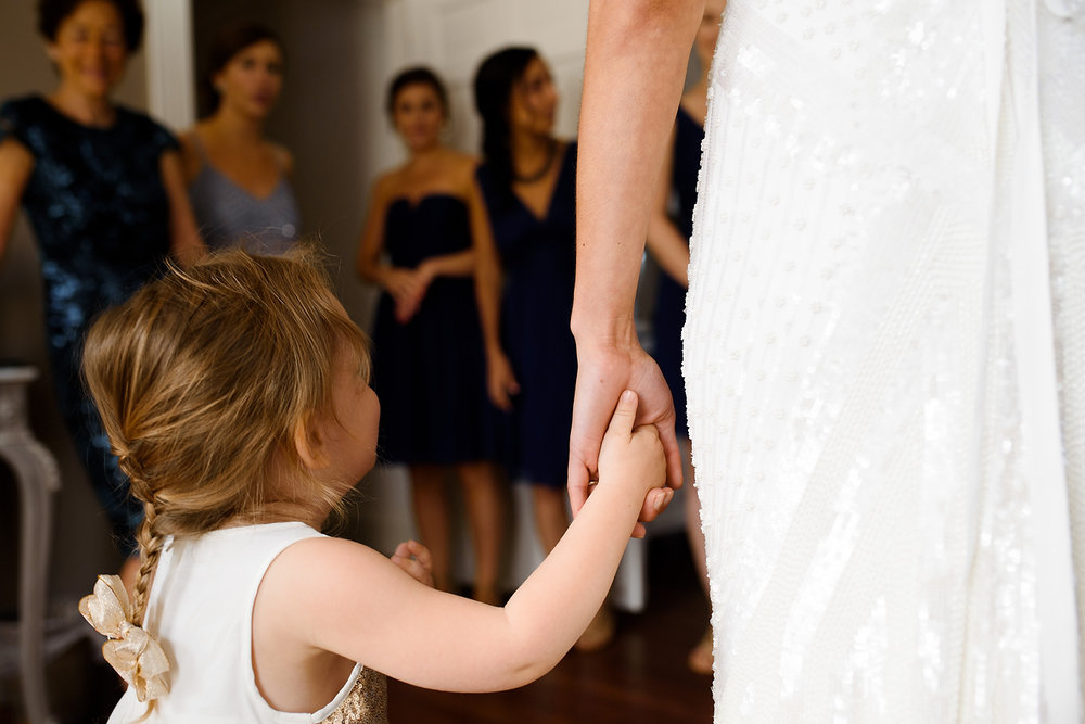 bride and flower girl moments at the dennis inn