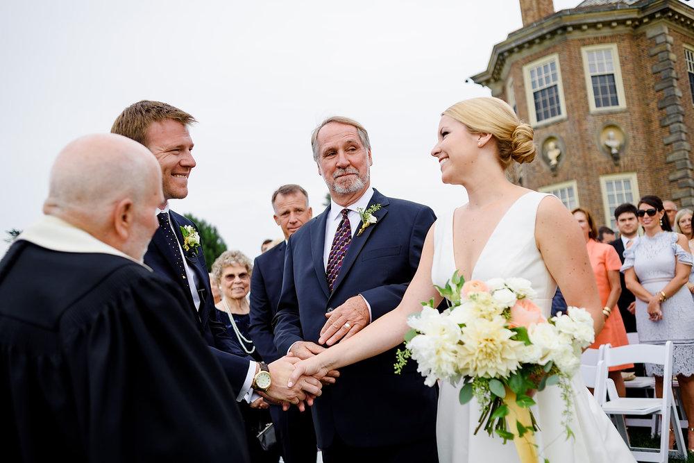 dad handing off bride at the crane estate