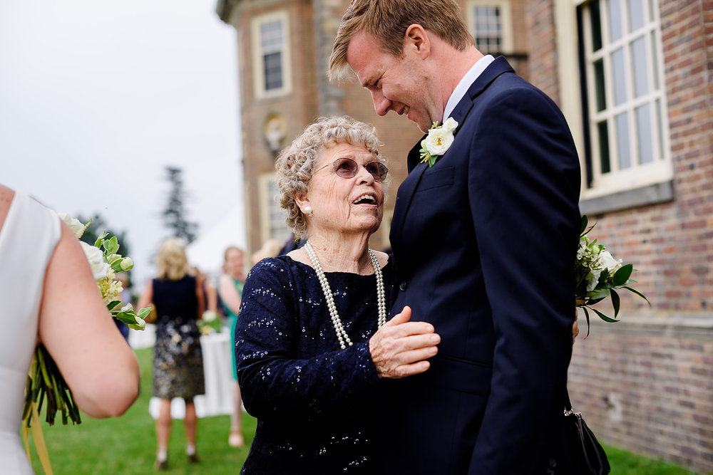 real moments with grandma and groom at the crane estate