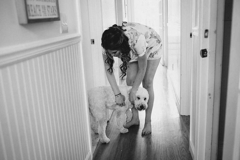 bride getting ready with her dog, dogs at weddings inspiration