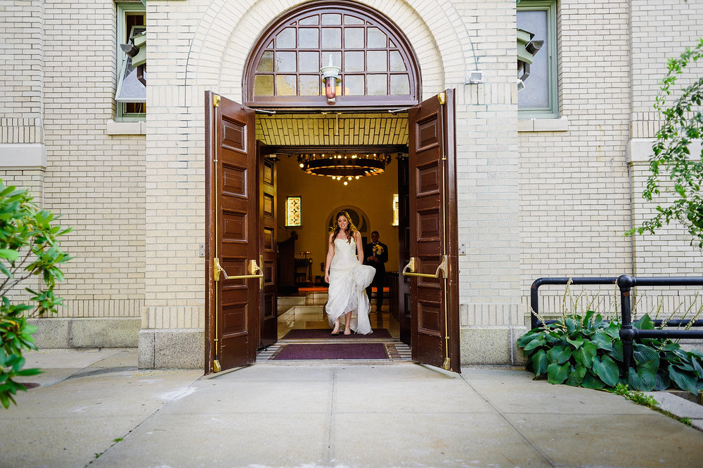 candid moment bride leaving the ceremony in newport, ri