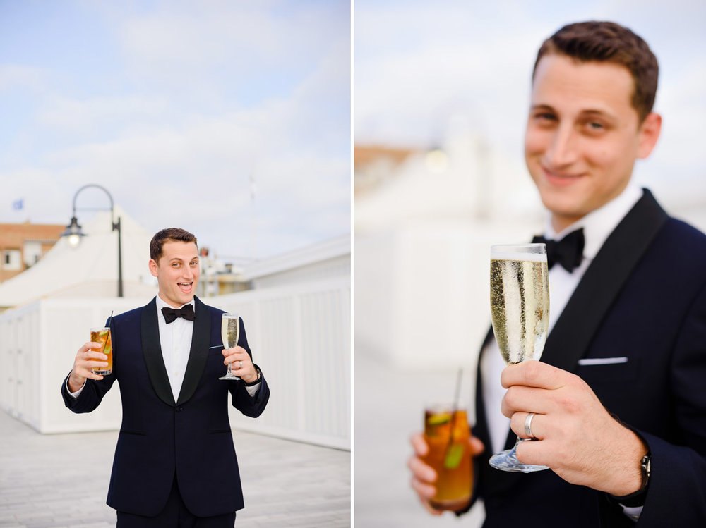 groom holding two drinks at the bohlin newport yacht club