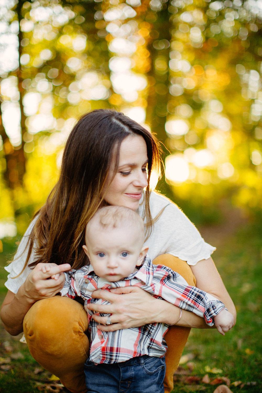 family portrait of mom holding son in winchester, massachusetts