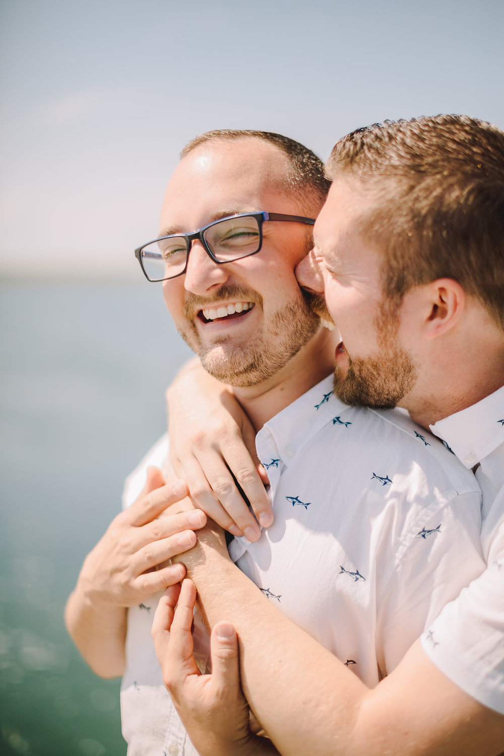 cute gay couple loving each other in provincetown, ma