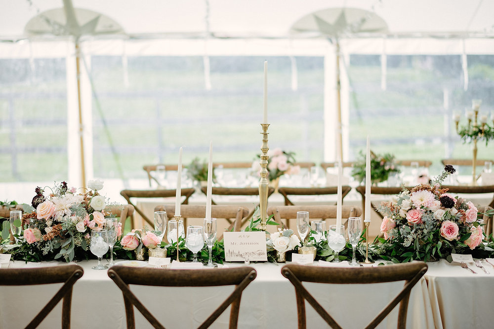 stunning tent and details with tall candles mountain wedding