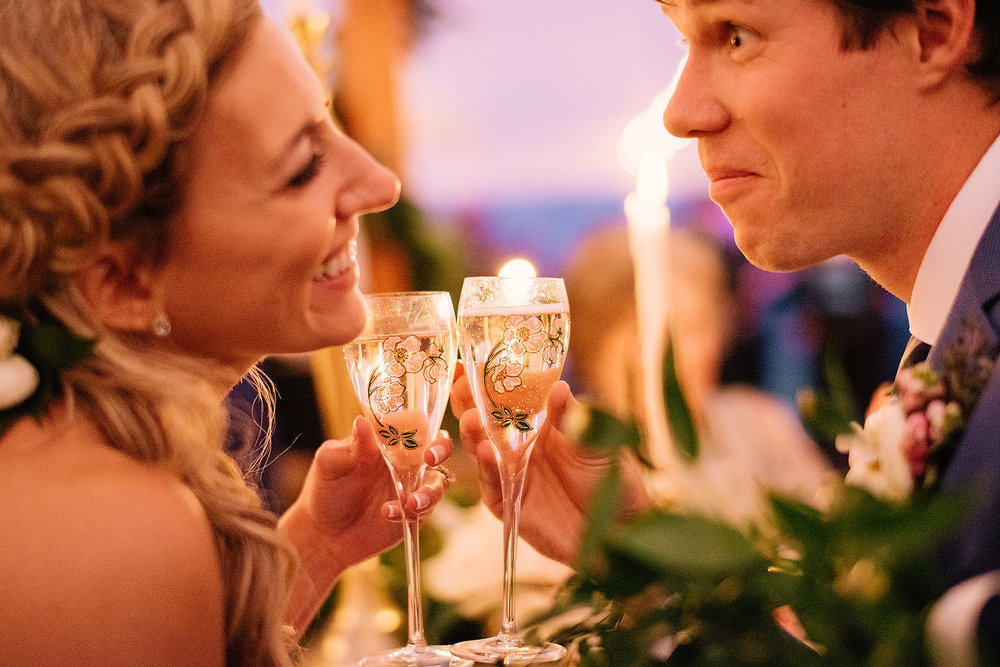 fun bride and groom toast photo in new england and new hampshire