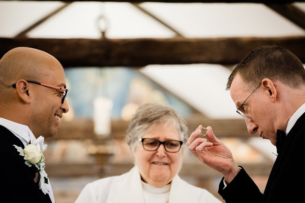 two grooms with rings in provincetown