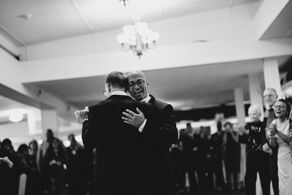 timeless black and white first dance with two grooms