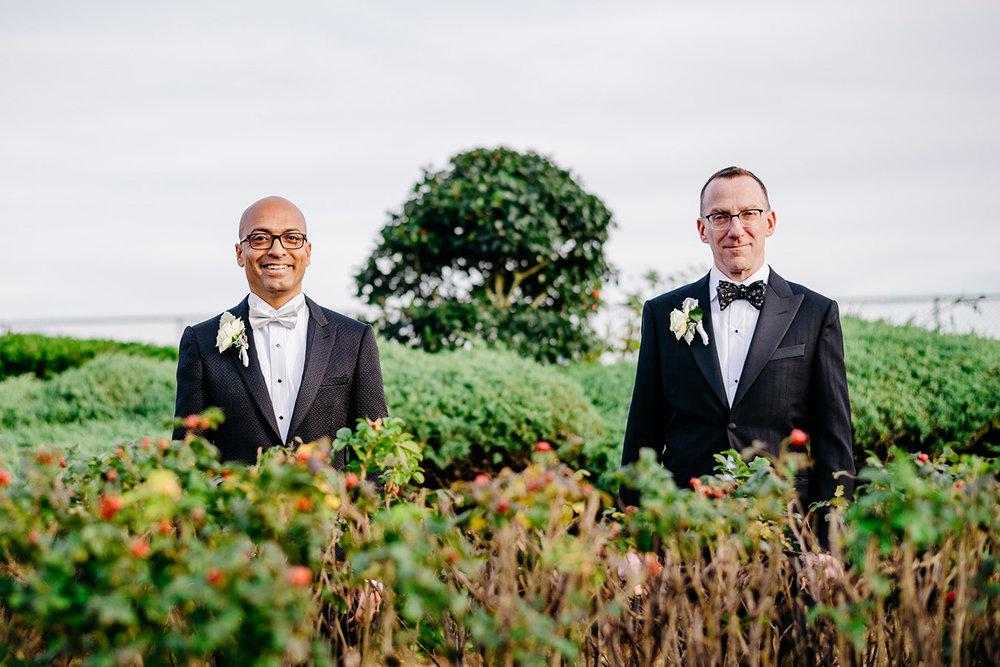 beautiful portrait in downtown provincetown with two stylish grooms