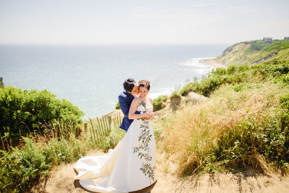 epic wedding portrait on block island with ocean and light house views