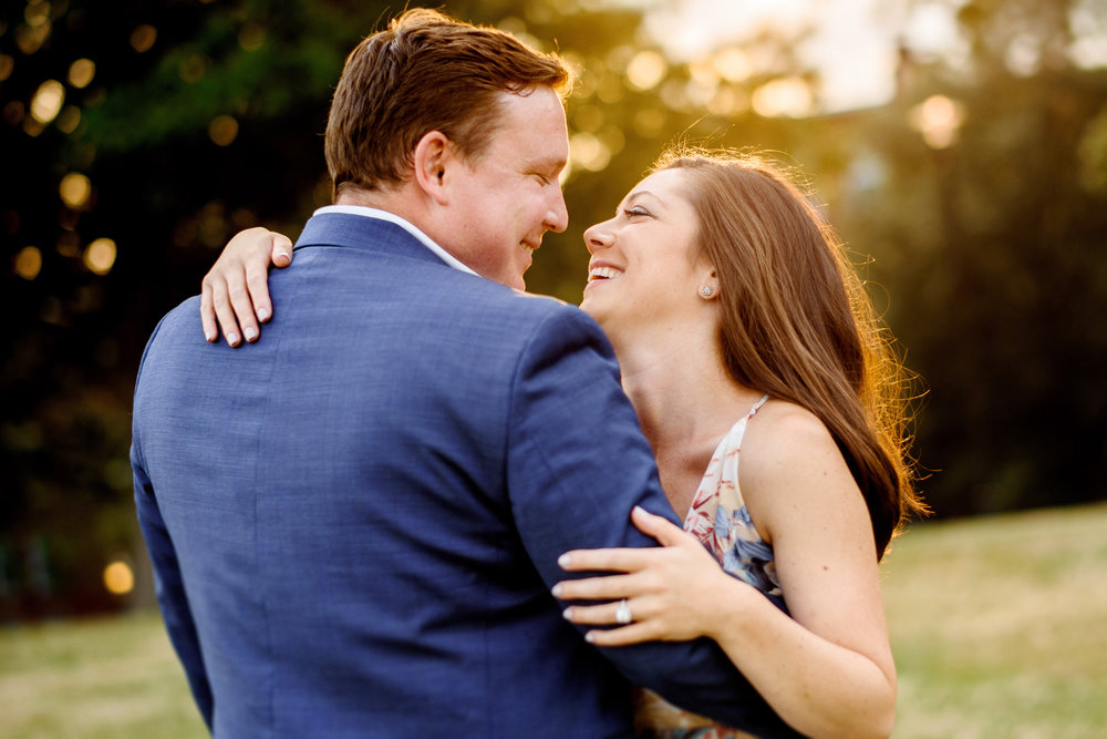 sunset portrait of a beauty couple at there bunker hill monument engagement session